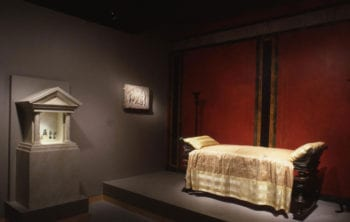 Photograph of the modern-day lararium structure in the Roman Galleries of the Walters Art Museum, Baltimore, MD, which houses bronze statuettes excavated from the Villa at Boscoreale.