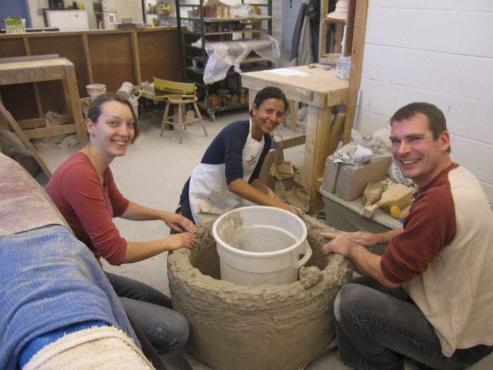 Working on the firing chamber of our replica ancient Greek kiln in the Baltimore Clayworks studios, January 2015.  L-R: Camilla Ascher, Sanchita Balachandran, and Matthew Hyleck