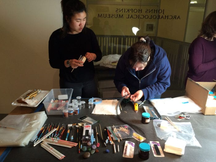 Hana Chop and Jill Waller making horsehair brushes for painting with slip.